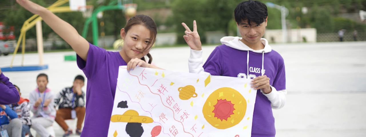 Peiyao Wang (2021) and Linhui Wu (2021) pose with a poster.